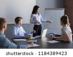 confident female business coach ... | Shutterstock . vector #1184389423
