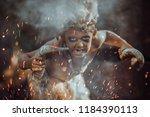 shaman boy at the fire. close... | Shutterstock . vector #1184390113