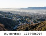 smoggy hilltop view of canyon... | Shutterstock . vector #1184406019