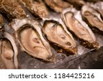 tasty fresh oysters close up on ... | Shutterstock . vector #1184425216