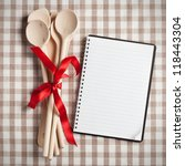 wooden kitchen utensil with blank recipe book - stock photo