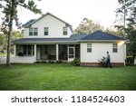 back side of new construction... | Shutterstock . vector #1184524603