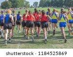cross country girls race taking ...   Shutterstock . vector #1184525869