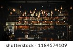 Stock photo vintage lamps with blurred liquor bar 1184574109