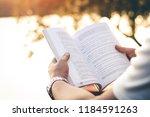 men sit reading book in quiet... | Shutterstock . vector #1184591263