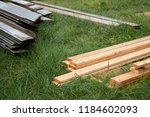 pile of new lumber and stack of ... | Shutterstock . vector #1184602093
