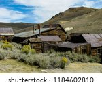 a cluster of old abandoned... | Shutterstock . vector #1184602810