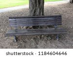 the bench is standing in the... | Shutterstock . vector #1184604646