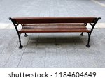 the bench is standing in the... | Shutterstock . vector #1184604649