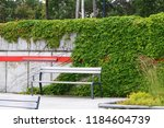 the bench is standing in the... | Shutterstock . vector #1184604739