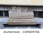 the bench is standing in the... | Shutterstock . vector #1184604766