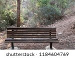 the bench is standing in the... | Shutterstock . vector #1184604769