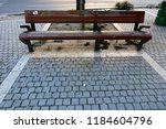 the bench is standing in the... | Shutterstock . vector #1184604796