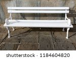 the bench is standing in the... | Shutterstock . vector #1184604820