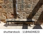 the bench is standing in the... | Shutterstock . vector #1184604823