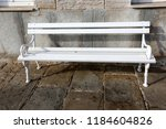 the bench is standing in the... | Shutterstock . vector #1184604826