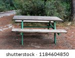 the bench is standing in the... | Shutterstock . vector #1184604850