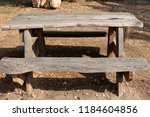 the bench is standing in the... | Shutterstock . vector #1184604856