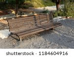 the bench is standing in the... | Shutterstock . vector #1184604916