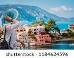 tourist woman wearing blue... | Shutterstock . vector #1184624596