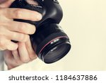 photographer with camera in hand | Shutterstock . vector #1184637886