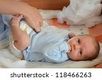 mother changing the baby's nappy | Shutterstock . vector #118466263