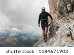 young male mountain climber on... | Shutterstock . vector #1184671903