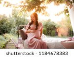 pregnant woman wearing stylish... | Shutterstock . vector #1184678383