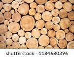 Wall Of Stacked Wood Logs As...