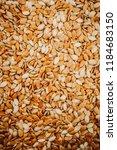 raw pumpkin seeds background... | Shutterstock . vector #1184683150