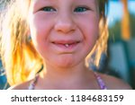 portrait of a little girl with... | Shutterstock . vector #1184683159