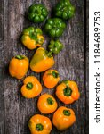 green and orange peppers on a... | Shutterstock . vector #1184689753