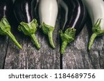 pieces of white and dark purple ... | Shutterstock . vector #1184689756