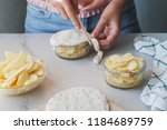 person makes small pies  covers ... | Shutterstock . vector #1184689759