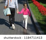 mom and little daughter are... | Shutterstock . vector #1184711413