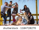 happy group of friends hanging... | Shutterstock . vector #1184728270