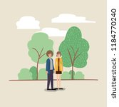 young couple walking on the park | Shutterstock .eps vector #1184770240