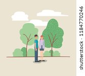young couple walking on the park | Shutterstock .eps vector #1184770246