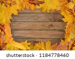 autumnal leaves frame on wooden ...   Shutterstock . vector #1184778460