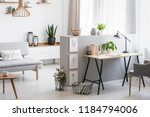 grey armchair at desk with... | Shutterstock . vector #1184794006