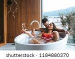 beautiful couple enjoying a... | Shutterstock . vector #1184880370