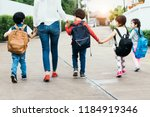 back to school students mother... | Shutterstock . vector #1184919346
