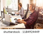 it support team working in an... | Shutterstock . vector #1184924449