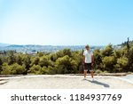 guy stands on the hill... | Shutterstock . vector #1184937769