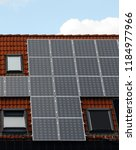 solar panels on roof of low... | Shutterstock . vector #1184977966
