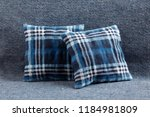 cozy blue checked cushions on... | Shutterstock . vector #1184981809