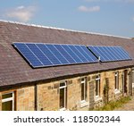 A roof mounted photovoltaic panel system - stock photo