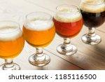 refreshing cold beer flight... | Shutterstock . vector #1185116500