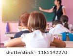 group of school kids sitting... | Shutterstock . vector #1185142270
