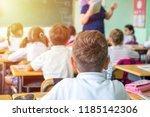 group of school kids sitting... | Shutterstock . vector #1185142306